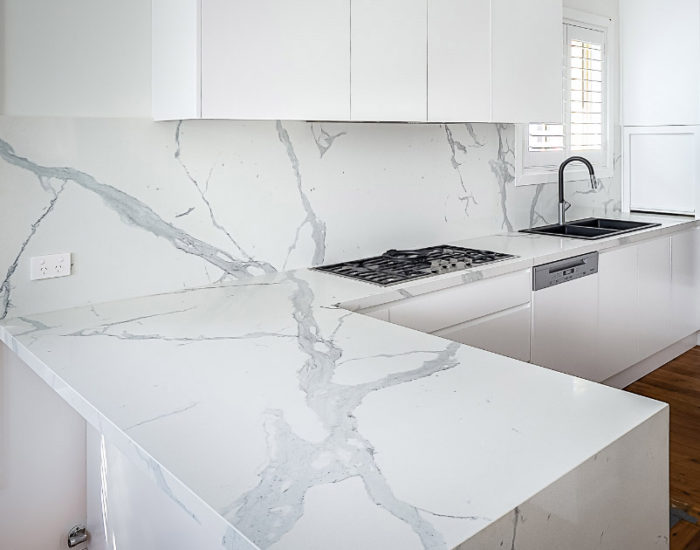 Marble benchtop resurfacing with Marble splashback in a white kitchen renovation north shore